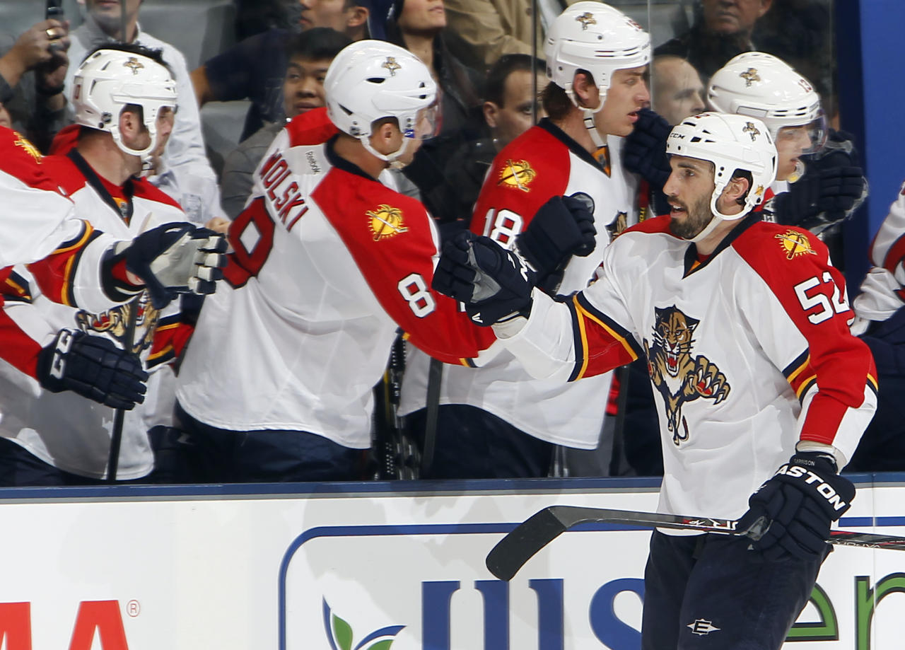 TORONTO, CANADA - FEBRUARY 28: Jason Garrison #52 of the Florida Panthers celebrates his goal against the Toronto Maple Leafs during NHL action at the Air Canada Centre February 28, 2012 in Toronto, Ontario, Canada. (Photo by Abelimages/Getty Images)