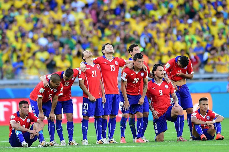 Chile's team line-up during the penalty shoot out after extra-time in the Round of 16 football match between Brazil and Chile at The Mineirao Stadium in Belo Horizonte during the 2014 FIFA World Cup on June 28, 2014