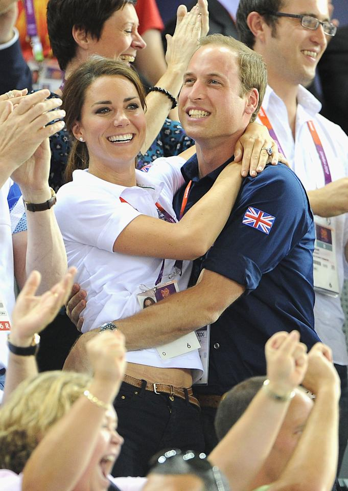 LONDON, ENGLAND - AUGUST 02:  Catherine, Duchess of Cambridge and Prince William, Duke of Cambridge embrace after Philip Hindes, Jason Kenny and Sir Chris Hoy of Great Britain win the gold and a new world record in the Men's Team Sprint Track Cycling final    during Day 6 of the London 2012 Olympic Games at Velodrome on August 2, 2012 in London, England. (Photo by Pascal Le Segretain/Getty Images)