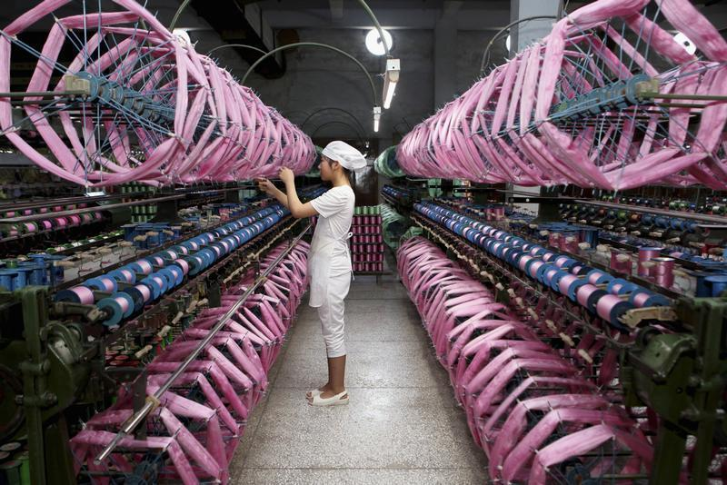 An employee works inside a silk factory in Neijiang