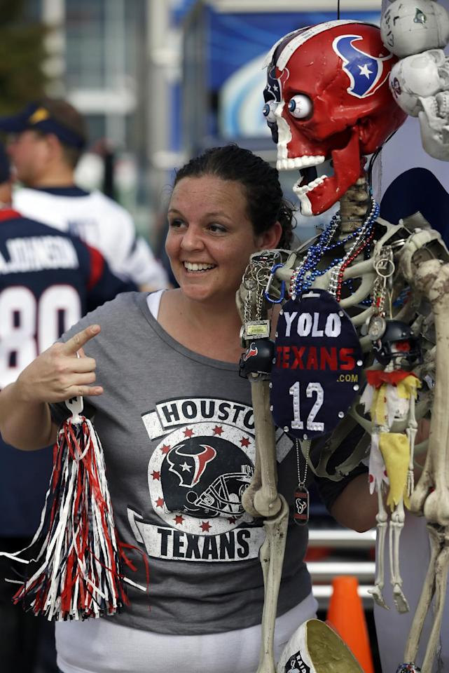 Ericka Amador of Houston gets her picture taken outside Reliant Stadium before an NFL football game between the Houston Texans and the Oakland Raiders Sunday, Nov. 17, 2013, in Houston. (AP Photo/Tony Gutierrez)