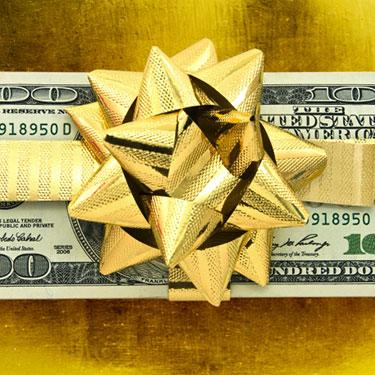 Hundred-dollar-bill-with-gold-bow_web