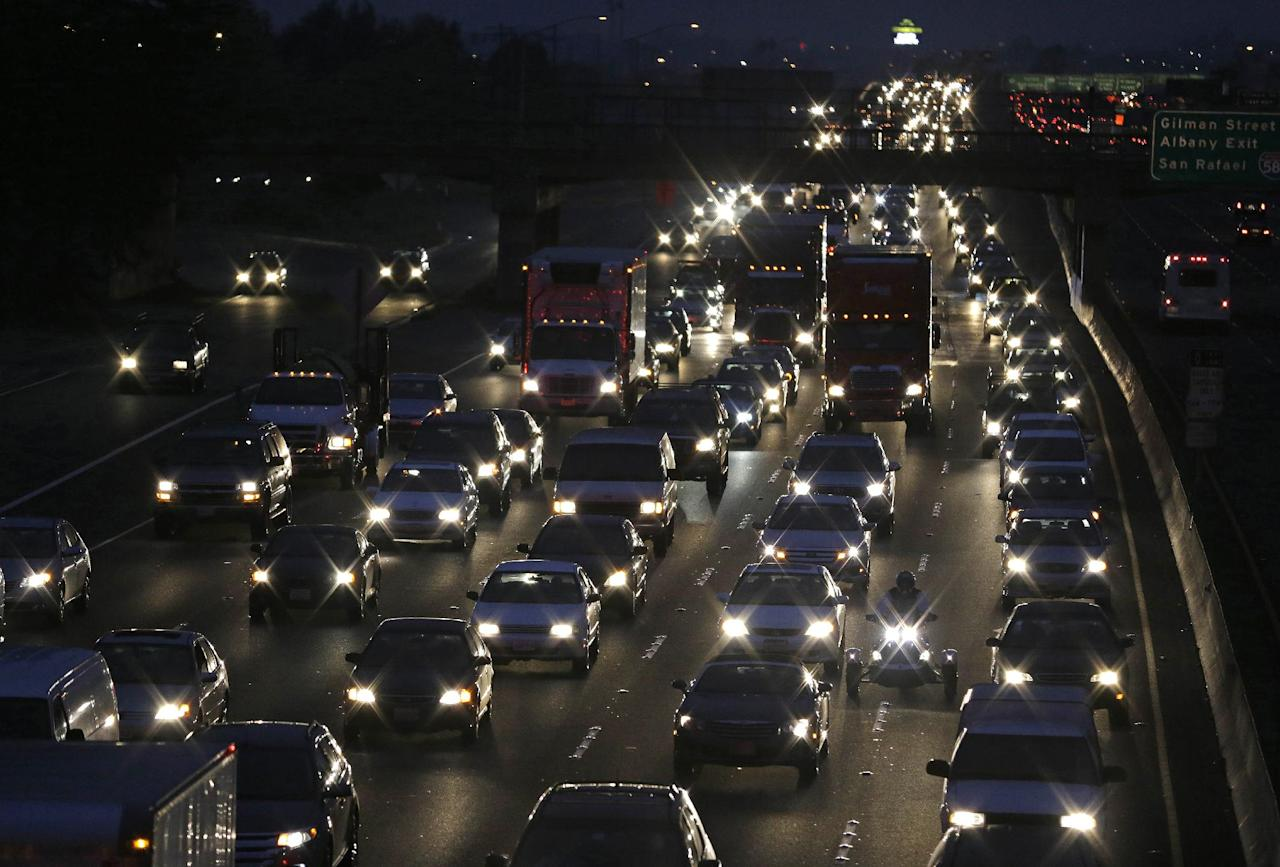 With the BART transit system on strike, traffic slows on Interstate 80 leading to the San Francisco-Oakland Bay Bridge during the morning commute Monday, Oct. 21, 2013, in Berkeley, Calif. San Francisco Bay Area commuters started the new work week on Monday with gridlocked roadways and long lines for buses and ferries as a major transit strike entered its fourth day. At the same time, federal investigators were searching for clues to a weekend train crash that killed two workers. (AP Photo/Eric Risberg)