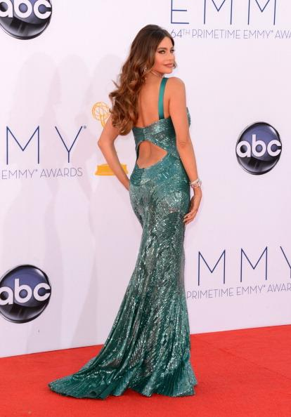 """<div class=""""caption-credit""""> Photo by: Getty Images</div><div class=""""caption-title"""">Dress of the year</div>The Zuhair Murad sequined turquoise gown Vergara wore to this year's Emmy Awards is undoubtedly our favorite red carpet look of 2012. The mermaid-style gown, which the actress has become synonymous with, was included in every Emmy best dressed list. And even though a little wardrobe malfunction almost marred her night, the beautiful Murad gown has now become Vergara's Hollywood classic. <br> <br> <b><a target=""""_blank"""" href=""""http://shine.yahoo.com/latina/"""">For content that speaks to you, visit Shine Latina</a></b>"""