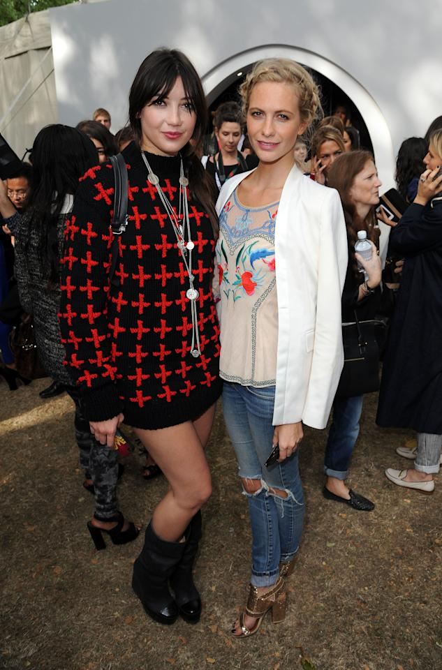 LONDON, UNITED KINGDOM - SEPTEMBER 16: Daisy Lowe and Poppy Delevigne attends the front row for the Unique show on day 3 of London Fashion Week Spring/Summer 2013 at TopShop Venue on September 16, 2012 in London, England. (Photo by David M. Benett/Getty Images)