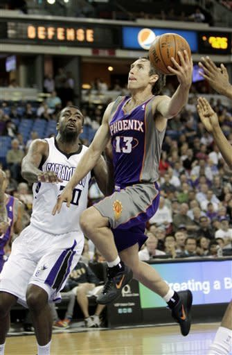 Phoenix Suns guard Steve Nash, right, drives to the basket against Sacramento Kings forward Donte Greene during the first quarter of an NBA basketball game in Sacramento, Calif., Tuesday, April 3, 2012.(AP Photo/Rich Pedroncelli)