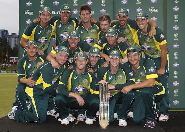 Australia pose with the trophy after defeating England. (AP Photo/Theron Kirkman)