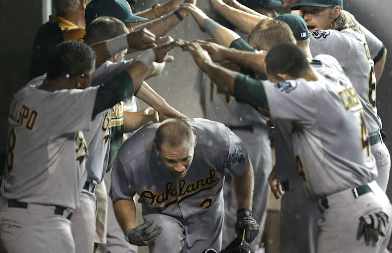 A's get rain-shortened 6-3 win over Tigers