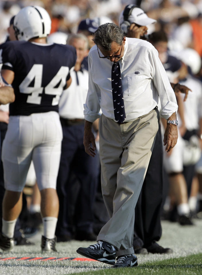 FILE - In this Oct. 6, 2007, file photo, Penn State head coach Joe Paterno kicks the turf as he walks along the sideline during NCAA college football game against Iowa in State College, Pa. Paterno, who preached success with honor for half a century but whose legend was shattered by a child sex abuse scandal, said Wednesdaym Nov. 9, 2011, the he will retire at the end of this season. (AP Photo/Carolyn Kaster, File)