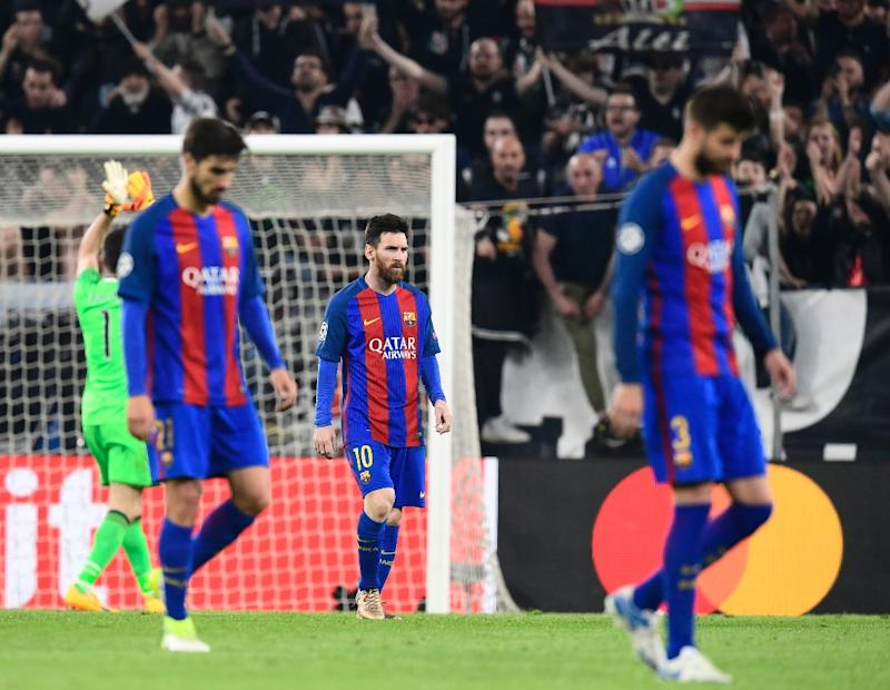 Barcelona's Lionel Messi and teammates look dejected at the end of their UEFA Champions League match against Juventus at the Juventus stadium in Turin