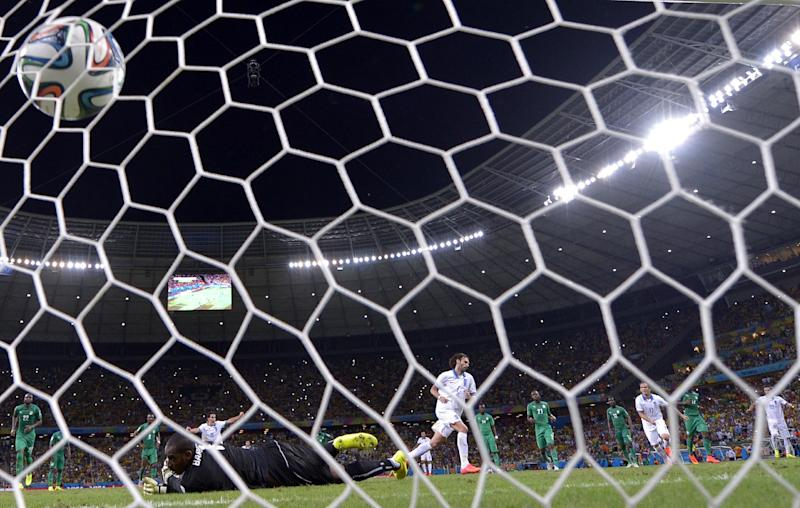 Ivory Coast's goalkeeper Boubacar Barry concedes a penalty to Greece's forward Georgios Samaras (back C) at the Castelao Stadium in Fortaleza during the 2014 FIFA World Cup on June 24, 2014