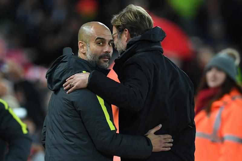Liverpool's manager Jurgen Klopp (R) greets Manchester City's manager Pep Guardiola ahead of the English Premier League football match between Liverpool and Manchester City at Anfield in Liverpool, north west England on December 31, 2016