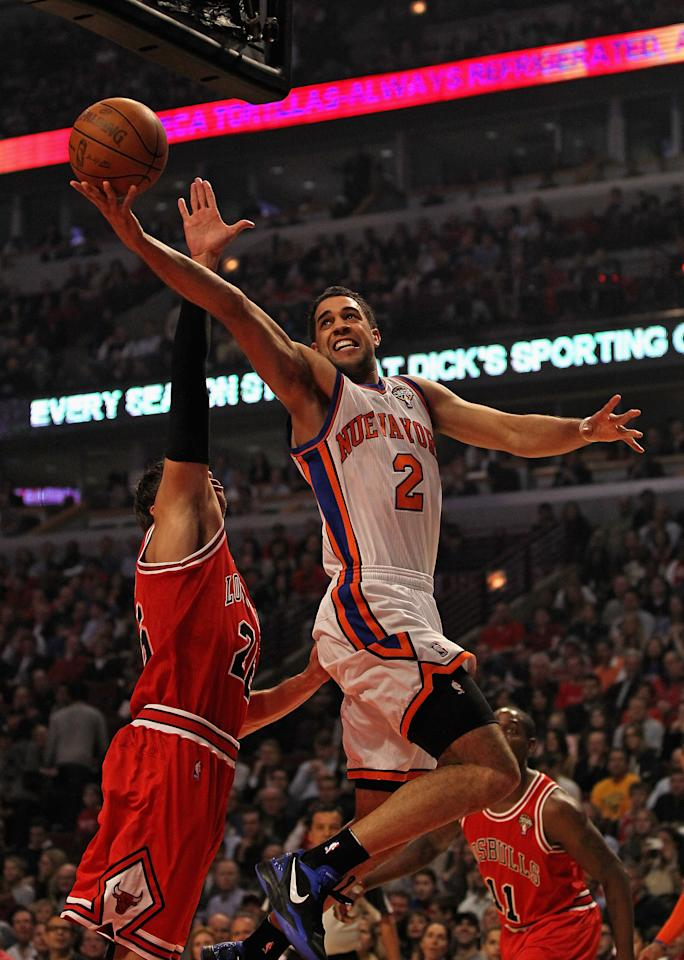 CHICAGO, IL - MARCH 12: Landry Fields #2 of the New York Knicks shoots over Kyle Korver #26 of the Chicago Bulls at the United Center on March 12, 2012 in Chicago, Illinois. NOTE TO USER: User expressly acknowledges and agrees that, by downloading and or using this photograph, User is consenting to the terms and conditions of the Getty Images License Agreement.  (Photo by Jonathan Daniel/Getty Images)