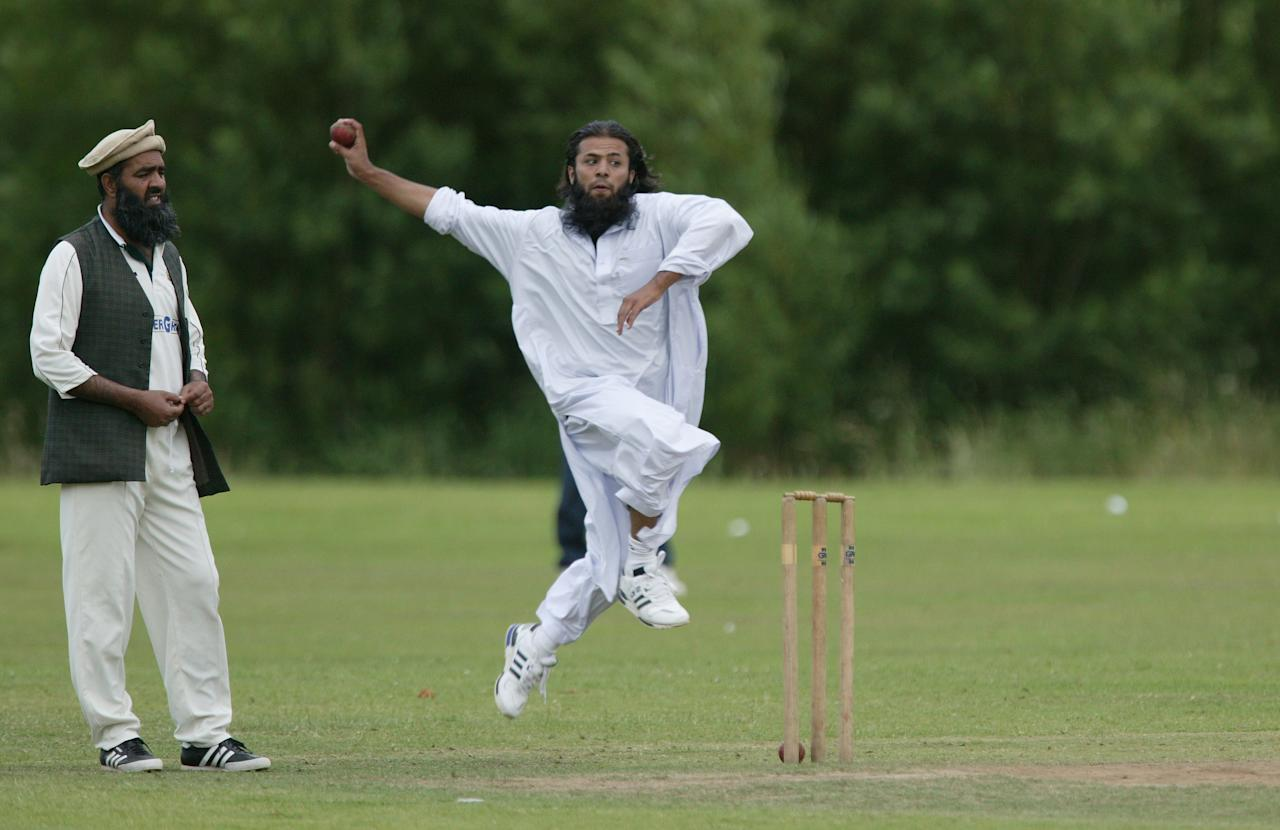 SOLTAIRE, ENGLAND - JULY 03: Players from Bradford play at Soltaire Cricket Club on July, 2003 in Soltaire, England.  (Photo by Laurence Griffiths/Getty Images)