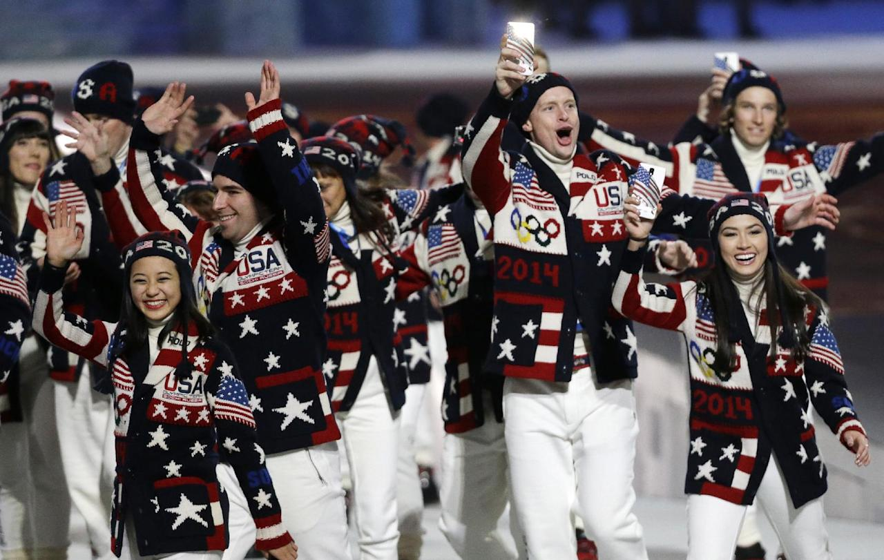 Athletes from the United States wave to spectators as they arrive during the opening ceremony of the 2014 Winter Olympics in Sochi, Russia, Friday, Feb. 7, 2014. (AP Photo/Mark Humphrey)