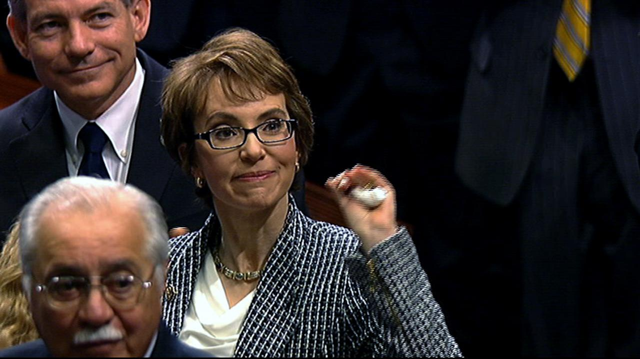 This video image provided by House Television shows Rep. Gabrielle Giffords, D-Ariz. on the floor of the House on Capitol Hill in Washington, Wednesday, Jan. 25, 2012. Giffords resigned from the House on Wednesday amid tears, tributes and standing ovations, more than a year after she was gravely wounded by a would-be assassin. (AP Photo/House Television)