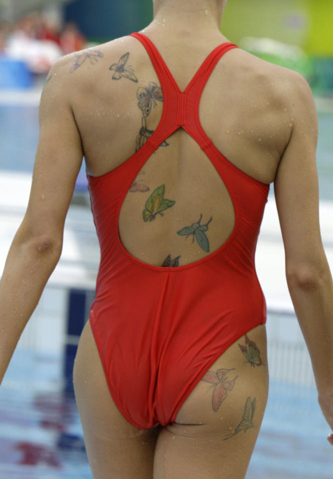 Russia's Anastasia Davydova has butterflies tattooed on her back as she prepares for a synchronized swimming training session after  the swimming competitions in the National Aquatics Center at the Beijing 2008 Olympics in Beijing, Sunday, Aug. 17, 2008. (AP Photo/Greg Baker)