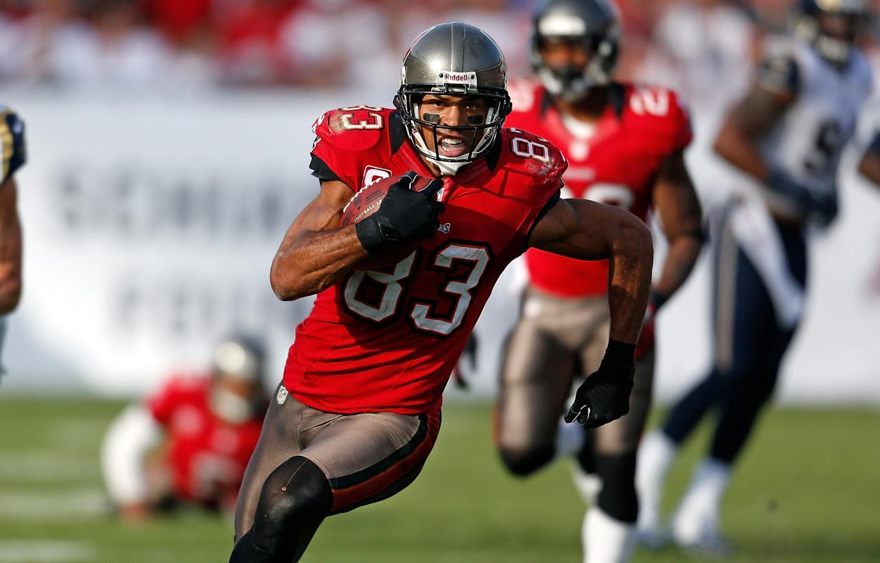 TAMPA, FL - DECEMBER 23:  Receiver Vincent Jackson #83 of the Tampa Bay Buccaneers runs after a catch against the St. Louis Rams during the game at Raymond James Stadium on December 23, 2012 in Tampa, Florida.  (Photo by J. Meric/Getty Images)