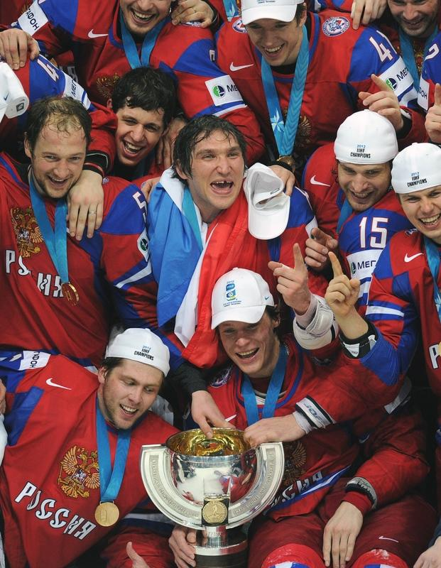 Russian team celebrate with a trophy after a final game of the IIHF International Ice Hockey World Championship in Helsinki on May 20, 2012, as Team Russia defeated team Slovakia 6-2 .   AFP PHOTO/ ALEXANDER NEMENOVALEXANDER NEMENOV/AFP/GettyImages