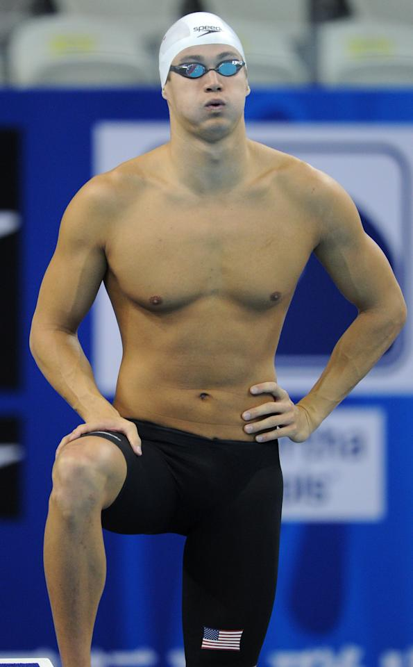 US swimmer Nathan Adrian gets ready prior to compete in the heats of the men's 100-metre freestyle swimming event in the FINA World Championships at the indoor stadium of the Oriental Sports Center in Shanghai on July 27, 2011.    AFP PHOTO / MARK RALSTON (Photo credit should read MARK RALSTON/AFP/Getty Images)