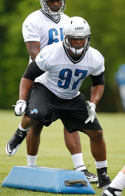ALLEN PARK, MI - MAY 12: Ronnell Lewis #97 of the Detroit Lions does a drill during a rookie mini camp at the Detroit Lions Headquarters and Training Facility on May 12, 2012 in Allen Park, Michigan. (Photo by Gregory Shamus/Getty Images)