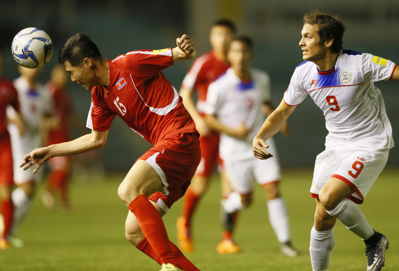 Ri Yong Chol, left, of North Korea executes a header while battling Philippine Azkals' Misagh Bahadoran (9) in the 2018 FIFA World Cup Russia and AFC Asian Cup UAE 2019 Preliminary Joint Qualification soccer match in Manila, Philippines, Tuesday, March 29, 2016. The Philippines won 3-2 to qualify for the second round of the AFC Asian Cup preliminary. (AP Photo/Bullit Marquez)