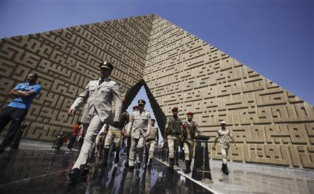 Members of the army walk at the tomb of late President Anwar Sadat during the 40th anniversary of Egypt's attack on Israeli forces in the 1973 war, at Cairo's Nasr City district, October 6, 2013. REUTERS/Amr Abdallah Dalsh
