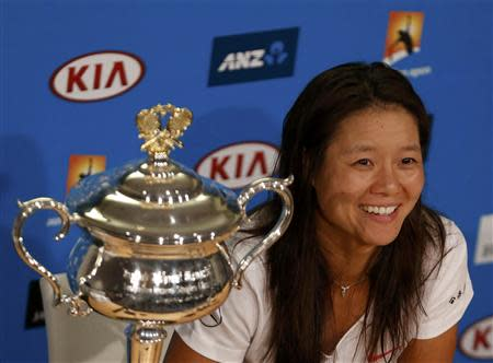 Li Na of China attends a news conference after winning her women's singles final match against Dominika Cibulkova of Slovakia at the Australian Open 2014 tennis tournament in Melbourne