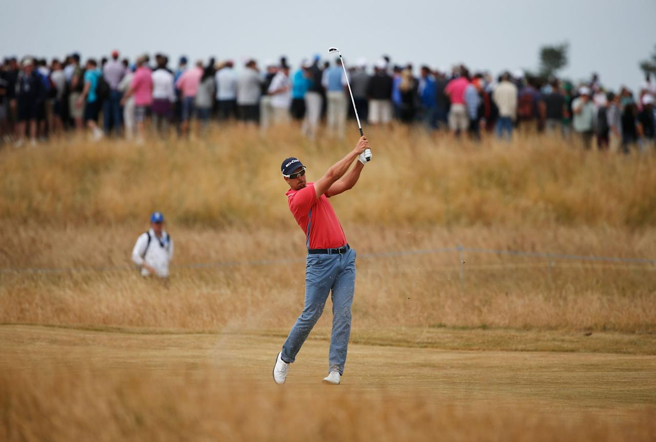 GULLANE, SCOTLAND - JULY 21: Henrik Stenson of Sweden hits his 3rd shot on the 8th during the final round of the 142nd Open Championship at Muirfield on July 21, 2013 in Gullane, Scotland. (Photo by Rob Carr/Getty Images)