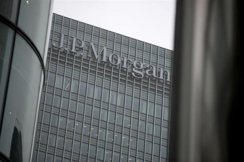 A sign is seen on the Canary Wharf offices of JP Morgan in London September 19, 2013.
