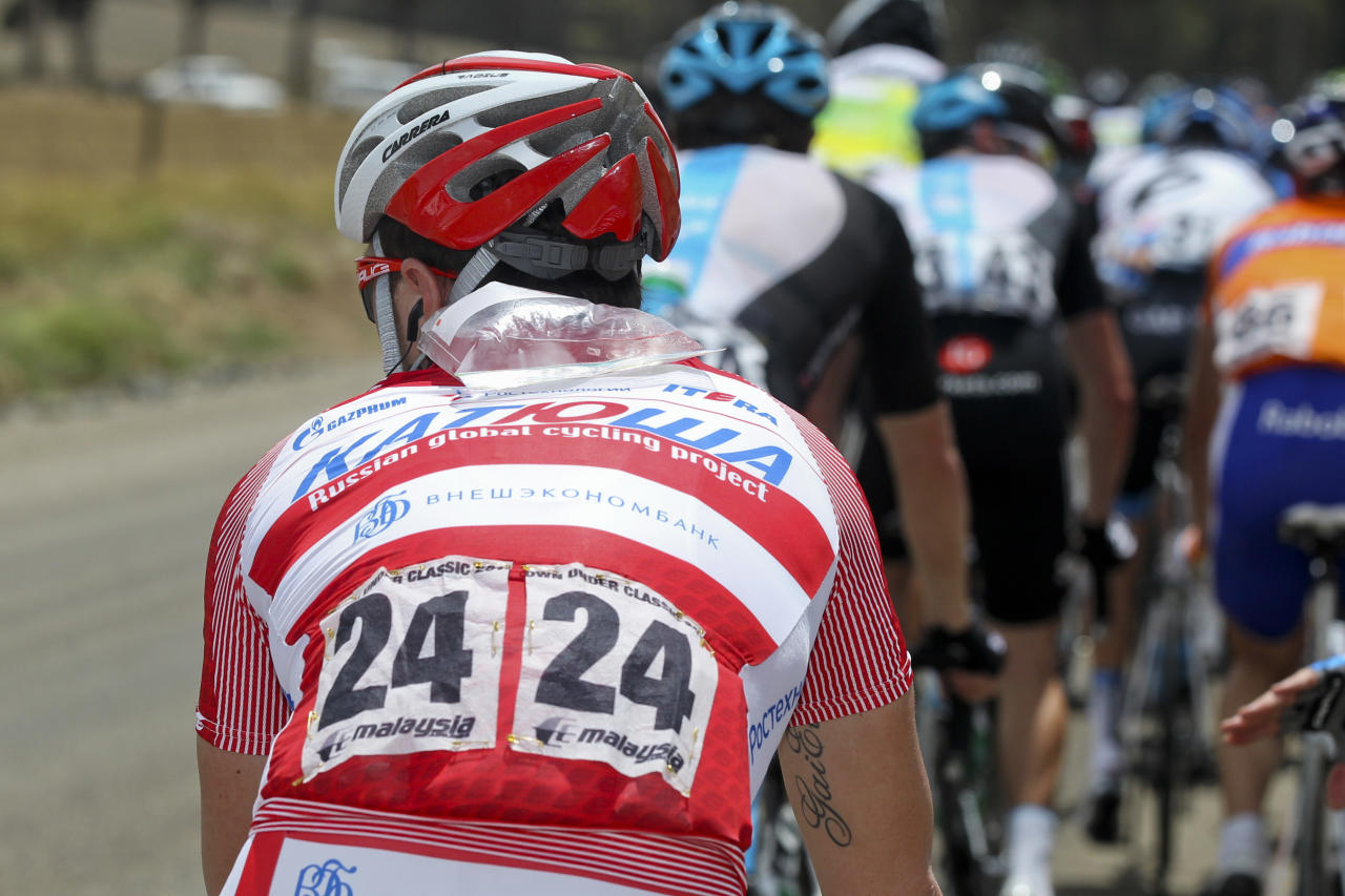 Luca Paolini from Italy rides with an ice pack on his neck during stage 1 of the 2012 Tour Down Under in Prospect on January 17, 2012.   The cycling's World Tour is held over six stages from January 15 to 22. IMAGE STRICTLY RESTRICTED TO EDITORIAL USE-STRICTLY NO COMMERCIAL USE      AFP PHOTO / Mark Gunter (Photo credit should read Mark Gunter/AFP/Getty Images)