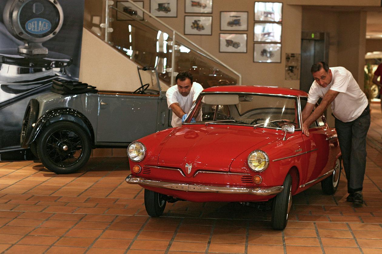 Workers set up a NSU Sport Prinz of 1968 from the collection of Prince Albert II of Monaco.