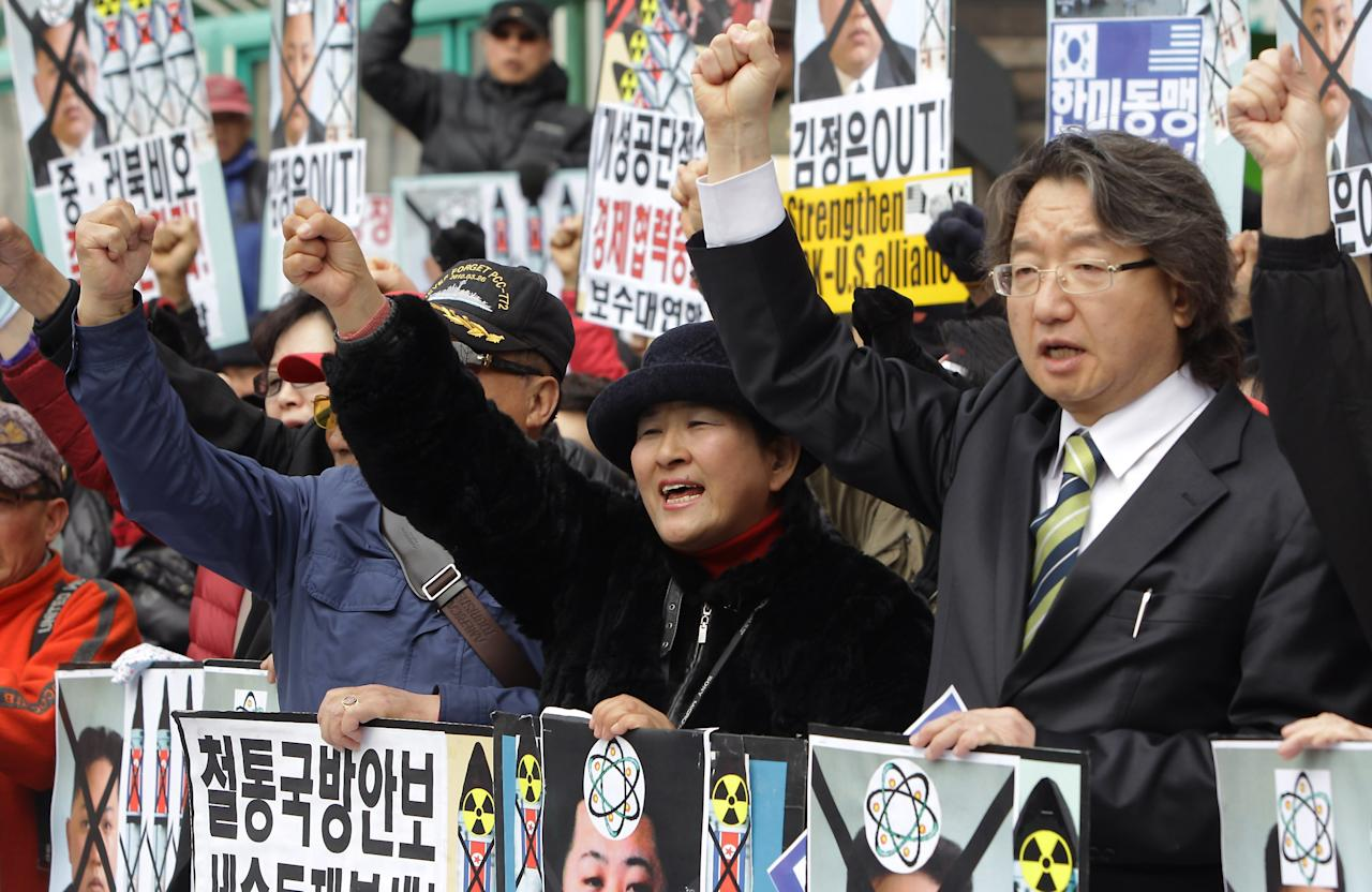 SEOUL, SOUTH KOREA - APRIL 15:  South Korean conservative protesters chant slogans during a rally demonstrating against North Korea on April 15, 2013 in Seoul, South Korea. North Korea marks its founder Kim Il-Sung's 101th birthday today while the fear on possible missile launch continues.  (Photo by Chung Sung-Jun/Getty Images)