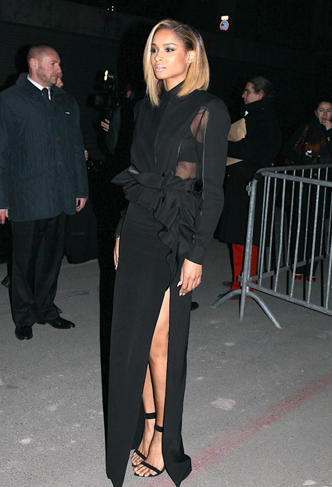 Meanwhile in Paris, Ciara played peekaboo in a semi-sheer Givenchy gown that featured mesh paneling and a thigh-high slit. What do you make of the R&B songstress' dramatic dress and dyed 'do? Too much or 2 Hot 2 Handle? (3/3/2013)
