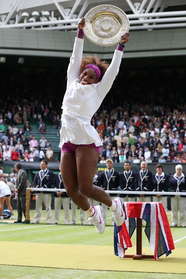 LONDON, ENGLAND - JULY 07:  Serena Williams of the USA jumps in the air with the winners trophy and celebrates after her Ladies? Singles final match against Agnieszka Radwanska of Poland on day twelve of the Wimbledon Lawn Tennis Championships at the All England Lawn Tennis and Croquet Club on July 7, 2012 in London, England.  (Photo by Julian Finney/Getty Images)
