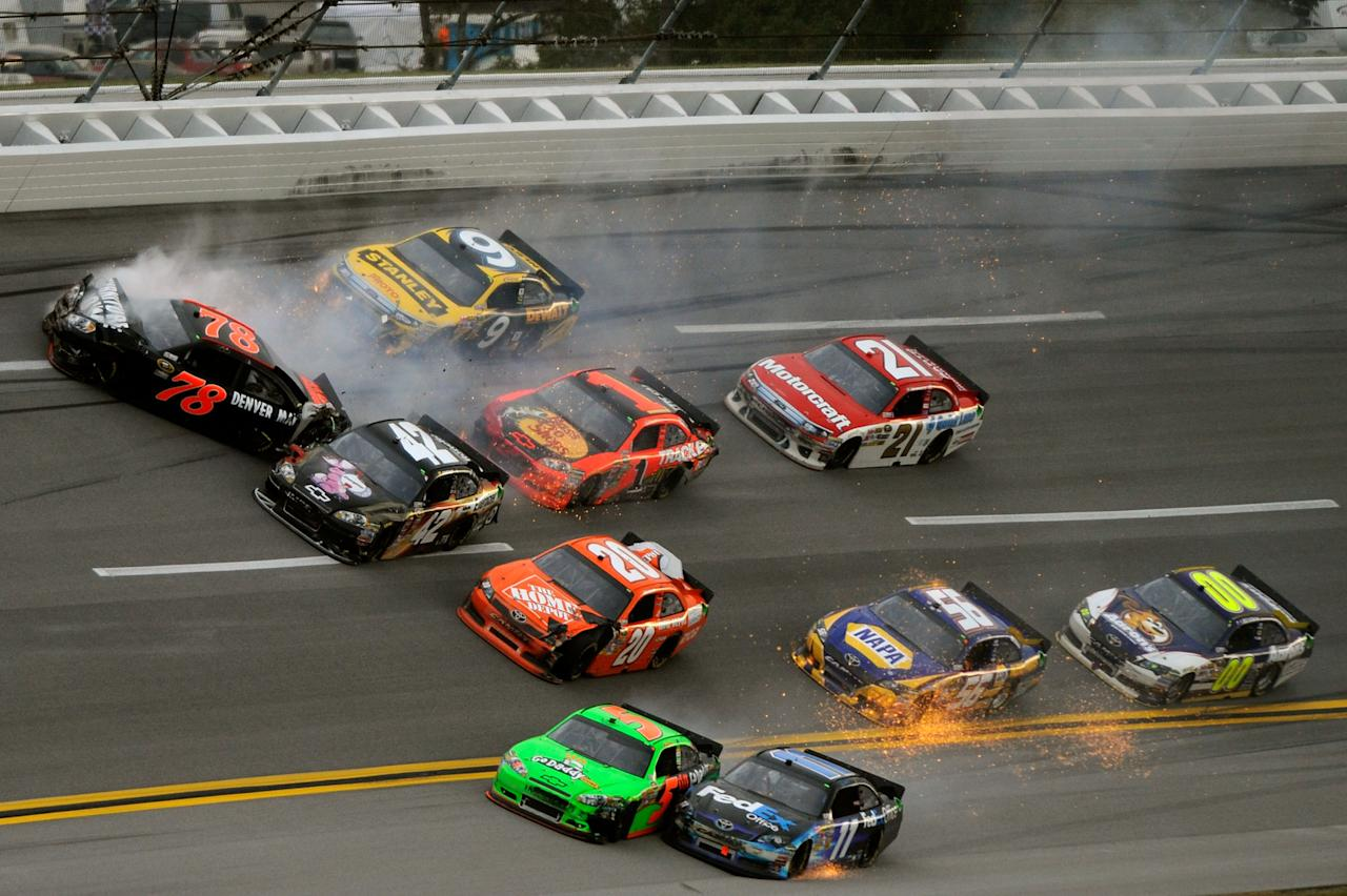 TALLADEGA, AL - OCTOBER 23:  Regan Smith, driver of the #78 Furniture Row Companies Chevrolet, crashes as Mark Martin, driver of the #5 GoDaddy.com Chevrolet, and Denny Hamlin, driver of the #11 FedEx Office Toyota, make contact during the NASCAR Sprint Cup Series Good Sam Club 500 at Talladega Superspeedway on October 23, 2011 in Talladega, Alabama.  (Photo by Jared C. Tilton/Getty Images for NASCAR)