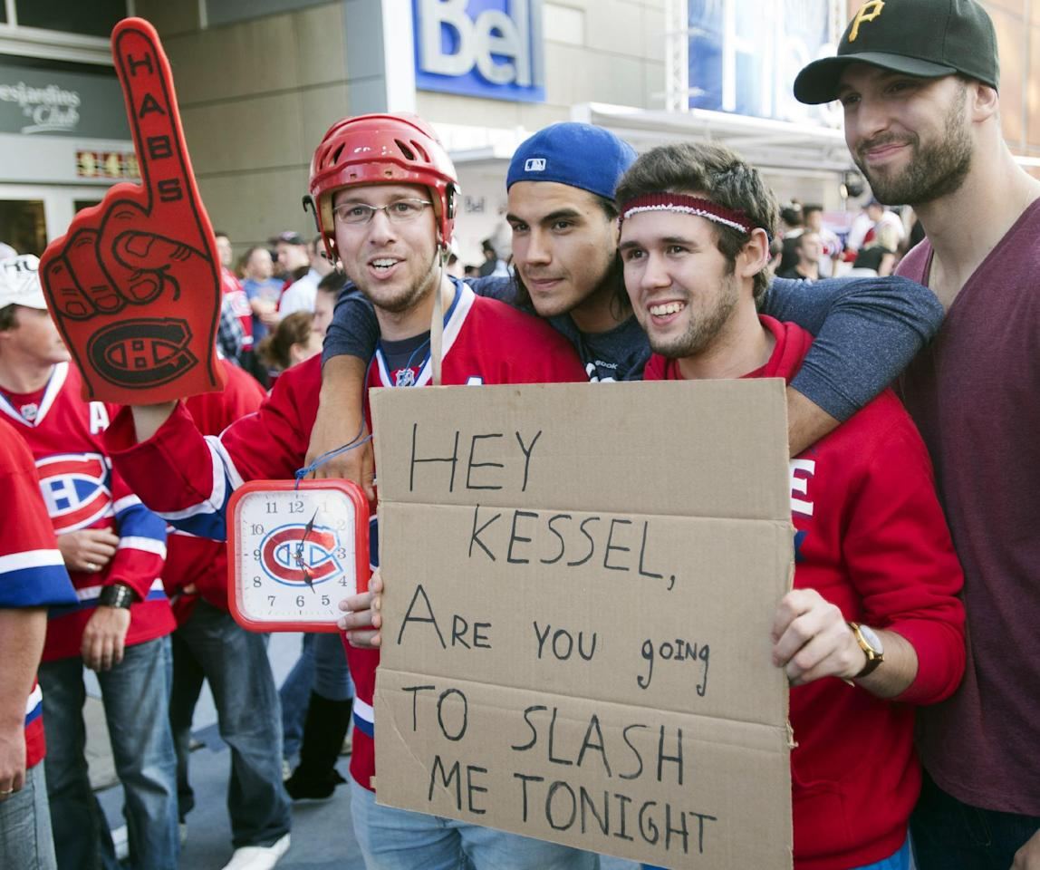 Montreal Canadien fans hold a message for Toronto Maple Leafs player Phil Kessel during the pre-game festivities before the a season opener NHL hockey game between the Maple Leafs and the Montreal Canadiens on Tuesday, October 1, 2013, in Montreal. (AP Photo/The Canadian Press, Ryan Remiorz)