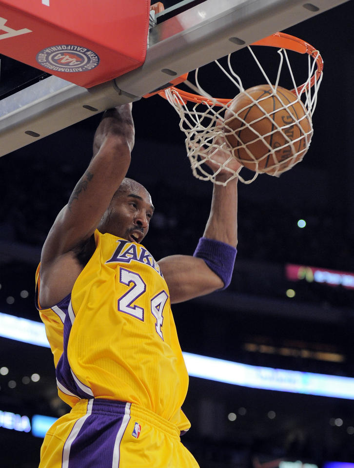 Los Angeles Lakers guard Kobe Bryant dunks during the first half of their NBA basketball game against the Cleveland Cavaliers, Friday, Jan. 13, 2012, in Los Angeles. (AP Photo/Mark J. Terrill)