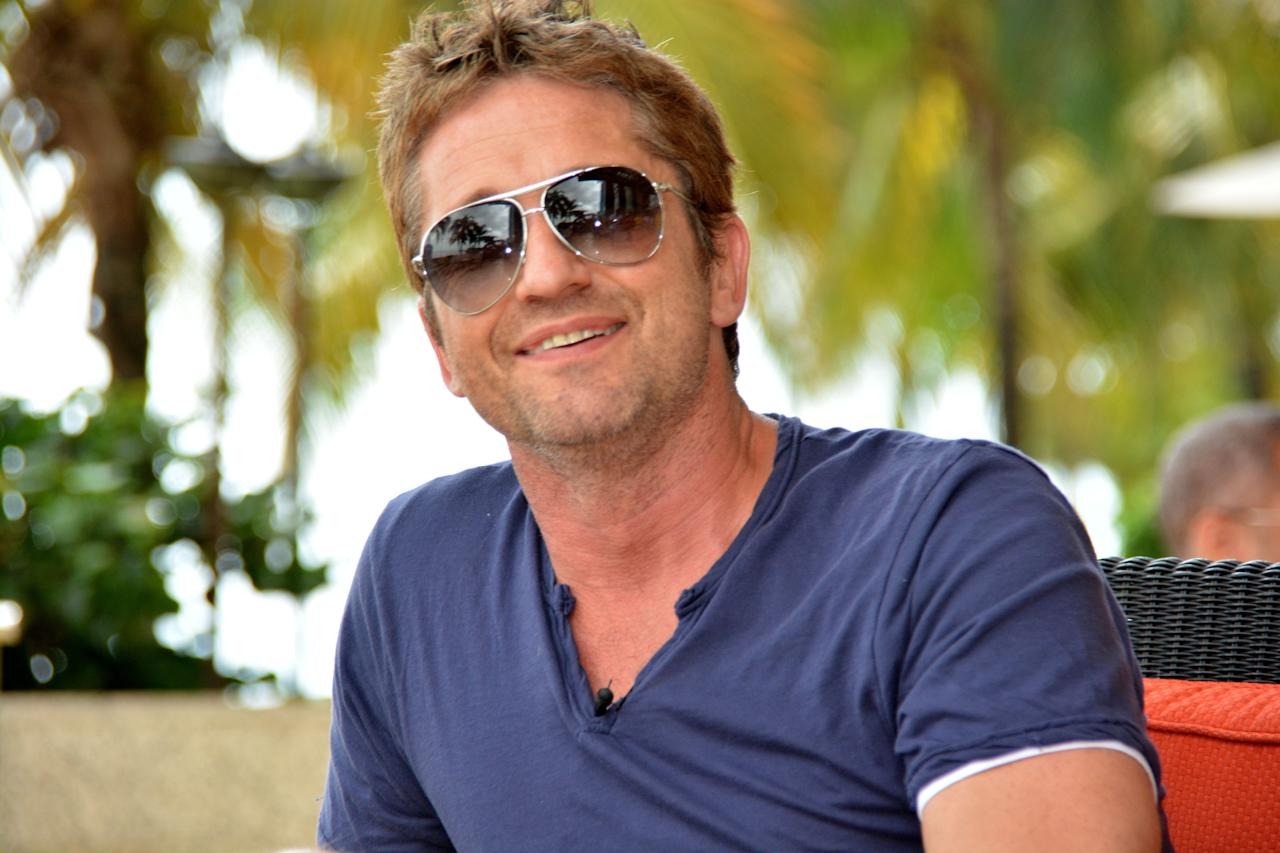 PORT OF SPAIN, TRINIDAD AND TOBAGO - AUGUST 23:  Actor Gerard Butler poses August 23, 2013 in Port of Spain, Trinidad & Tobago. Butler has an equity interest in the Jamaica Tallawahs team, who is in the semi-final.  (Photo by Lloyd Pierre/Getty Images Latin America for CPL)