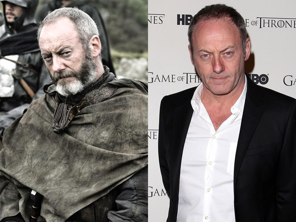 """<b>Liam Cunningham (Davos Seaworth)</b><br><br>That stern stare seems to be a permanent fixture for Liam Cunningham. Without the intense, black and white beard of his """"Games of Thrones"""" counterpart Davos Seaworth, Cunningham looks much younger off-screen. Although we still think he's a dead ringer for """"Parks and Recreation's"""" Nick Offerman. They could play brothers!"""