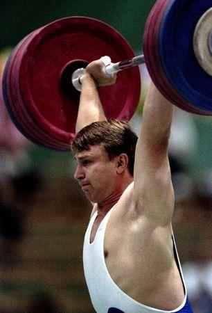 Sergei Syrtsov of Russia in action during the Goodwill Games 99 kg clean-and-jerk weightlifting category July 23, 1994. Reuters photographer