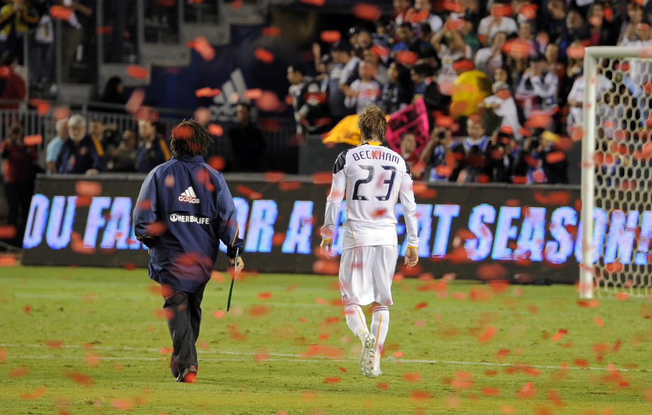 Los Angeles Galaxy midfielder David Beckham, right, and assistant coach Kobe Jones walk off the field after FC Dallas defeated them in their MLS Western Conference Final playoff match, Sunday, Nov. 14, 2010, in Carson, Calif. FC Dallas won 3-0.