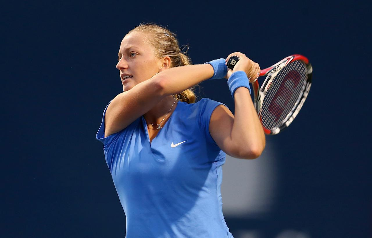 TORONTO, ON - AUGUST 08: Petra Kvitova of the Czech Republic hits a return in her 6-3, 6-3 win over Samantha Stosur of Australia on day four of the Rogers Cup Toronto at Rexall Centre at York University on August 8, 2013 in Toronto, Ontario, Canada. (Photo by Andy Lyons/Getty Images)