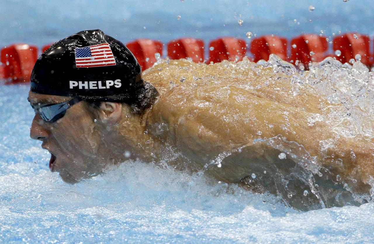 United States' Michael Phelps swims in the men's 4 X 100-meter medley relay at the Aquatics Centre in the Olympic Park during the 2012 Summer Olympics in London, Saturday, Aug. 4, 2012. (AP Photo/Michael Sohn)