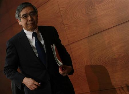 Bank of Japan Governor Kuroda leaves a news conference at the BOJ headquarters in Tokyo