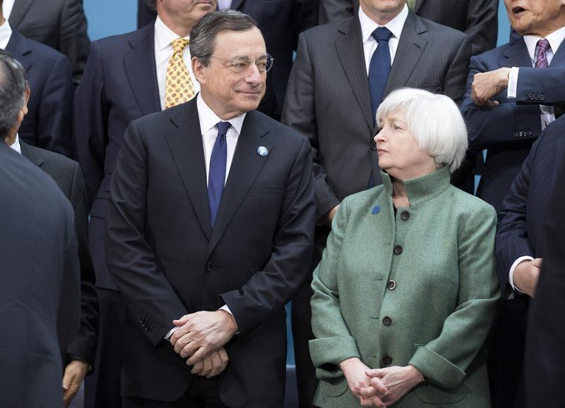 Draghi and Yellen speak before the G20 finance ministers and central bankers family portrait during the IMF/World Bank 2014 Spring Meeting in Washington