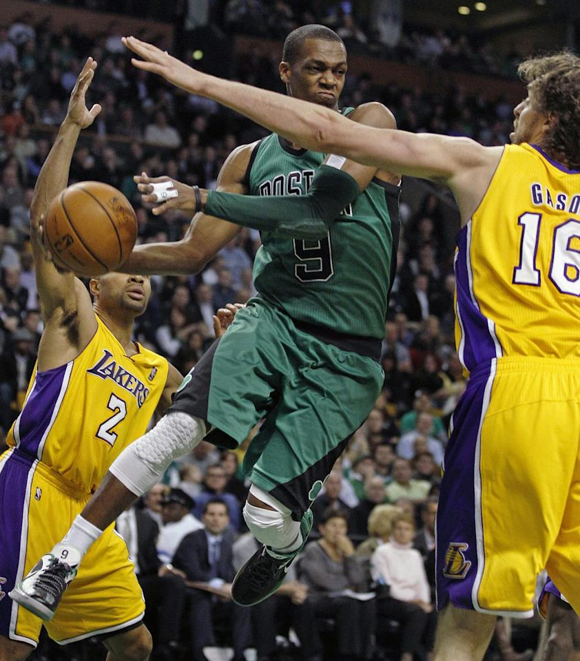 Boston Celtics guard Rajon Rondo (9) looks to pass between Los Angeles Lakers forward Pau Gasol (16) and guard Derek Fisher during the second quarter of an NBA basketball game in Boston, Thursday Feb. 9, 2012. (AP Photo/Charles Krupa)