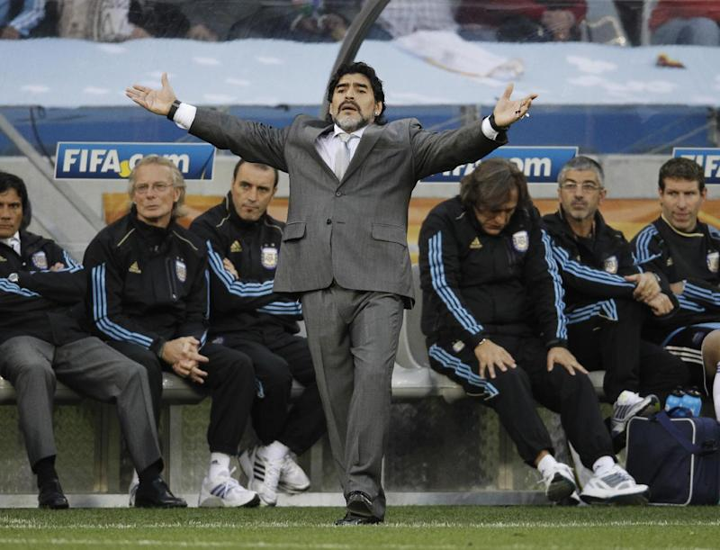 The July 3, 2010 file photo shows Argentina head coach Diego Maradona during the World Cup quarterfinal soccer match between Argentina and Germany at the Green Point stadium in Cape Town, South Africa. On Sunday, July 13, 2014, Germany and Argentina will face each other again in the final of the 2014 soccer World Cup