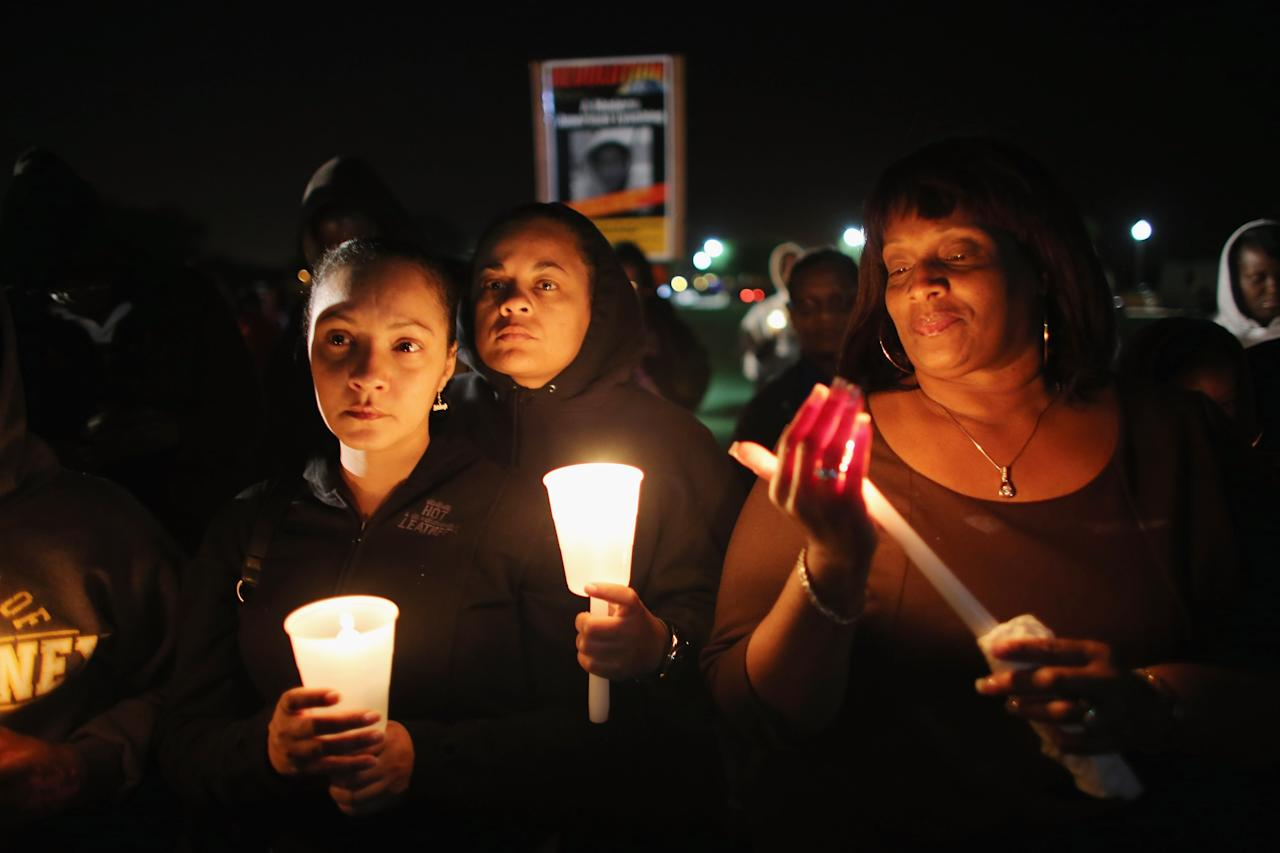 SANFORD, FL - FEBRUARY 26:  Shenika Mitchell and Yolanda Pearson (L-R) gather with others for a candle light vigil at Fort Mellon Park to mark the one year anniversary of when Trayvon Martin was killed on February 26, 2013 in Sanford, Florida. Martin was shot by George Zimmerman while Zimmerman was on neighborhood watch patrol in the gated community of The Retreat at Twin Lakes in Sanford, Florida.  (Photo by Joe Raedle/Getty Images)