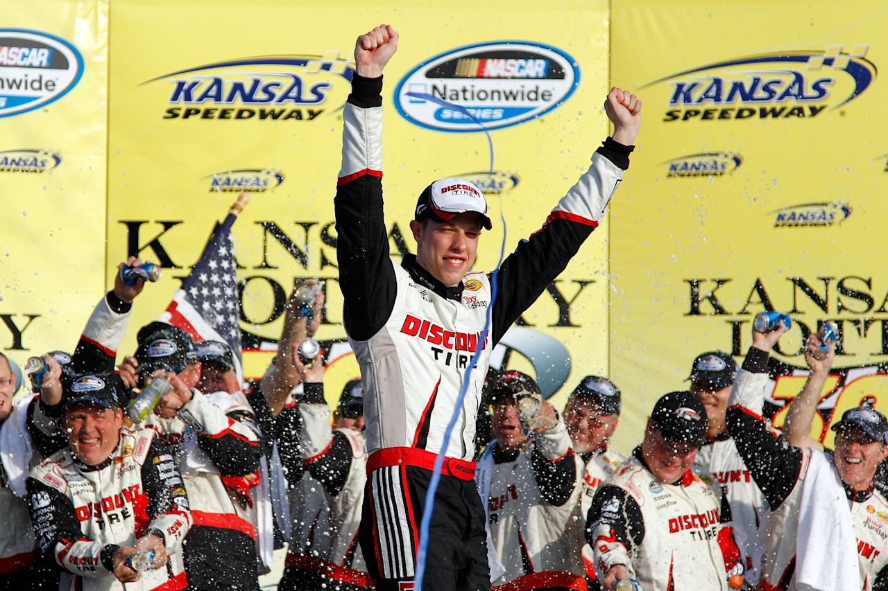 KANSAS CITY, KS - OCTOBER 08:  Brad Keselowski, driver of the #22 Discount Tire Dodge, celebrates in Victory Lane after winning the NASCAR Nationwide Series Kansas Lottery 300 at Kansas Speedway on October 8, 2011 in Kansas City, Kansas.  (Photo by Todd Warshaw/Getty Images for NASCAR)
